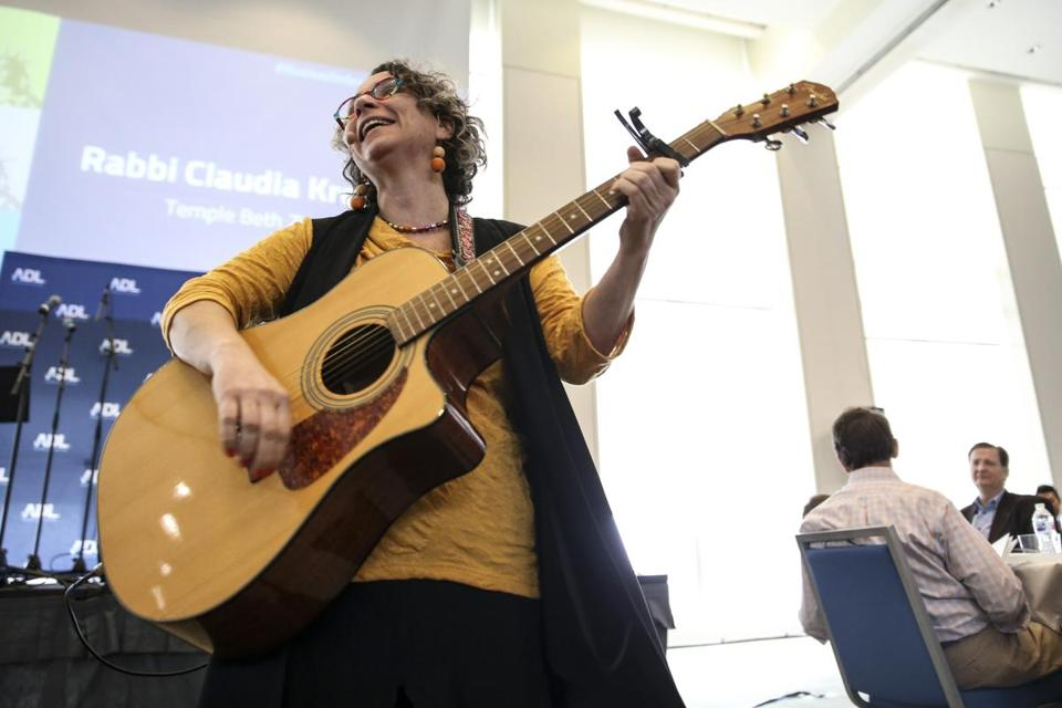 "Rabbi Claudia Kreiman of Temple Beth Zion sang at the Anti-Defamation League's 12th annual ""Nation of Immigrants"" community seder at UMass Boston on Sunday afternoon."