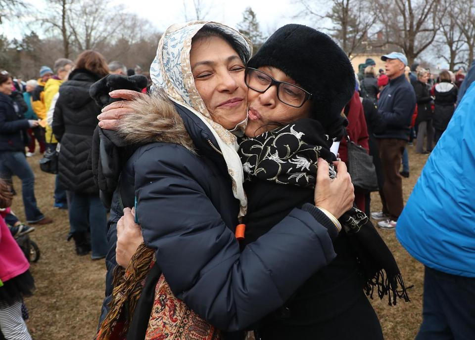 "Nila Karim (left) embraced longtime friend Fareena Sultan of Lexington during the vigil, called ""Lexington stands with our Muslim neighbors and friends."""