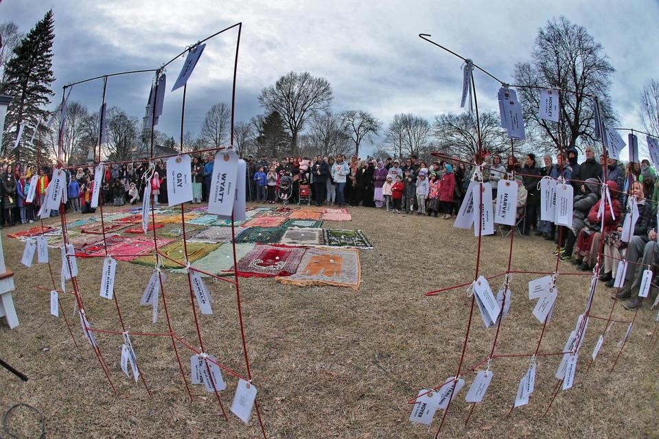 Tags and prayer rugs were used as symbols to honor the victims of the Christchurch, New Zealand, shooting.
