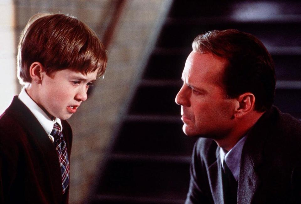 ADVANCE FOR WEEKEND EDITIONS, MARCH 23-26--Haley Joel Osment, left, and Bruce Willis appear in a scene from the film 'The Sixth Sense,' a tale of a child who can see ghosts. Osment received an Oscar nomination for best supporting actor for his role in the film, which received six nominations, including best film. The Oscars will be announced at trhe Academy Awards ceremony March 26, 2000. (AP Photo/Spyglass Enterainment, Ron Phillips) library tag 03272000 living arts library tag 06242001 MOVIES Library Tag 07282002 Movies Library Tag 10162005 TV Week