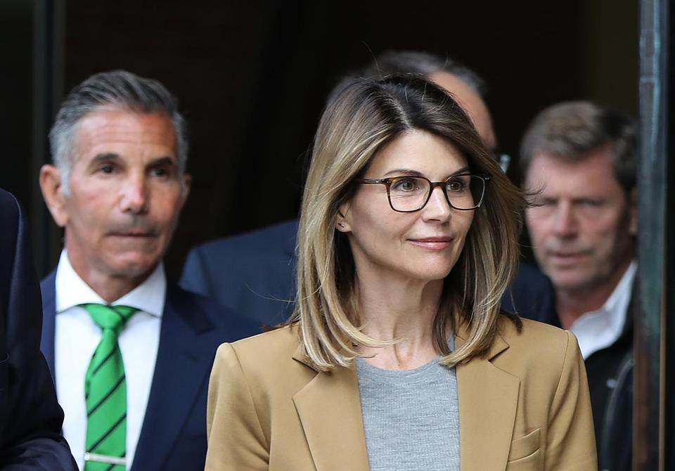 Boston, MA - 4/3/19 Lori Loughlin (cq) and her husband Mossimo Giannulli (cq) (green tie) leave court. More parents accused of bribery in the college admissions scandal appear at federal court. Photo by Pat Greenhouse/Globe Staff Topic: 04collegescandal