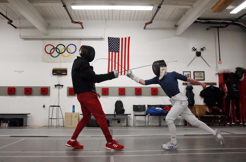 David Hermann (à droite), XNUMX ans, a été masqué par un masque pendant une leçon.