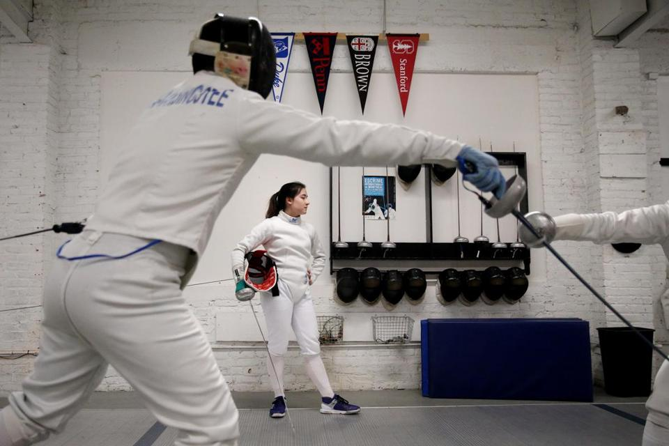 Sophie Yee, 17, waited for her partner during a training session at Bay State Fencers in Somerville on Friday.