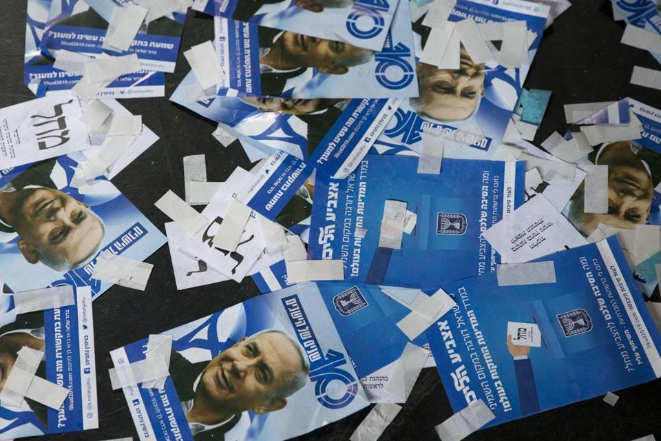 Likud party ballot papers and Israel's Prime Minister Benjamin Netanyahu's campaign fliers are seen on the ground after polls for Israel's general elections closed in Tel Aviv, Israel, Wednesday, April 10, 2019. (AP Photo/Ariel Schalit)