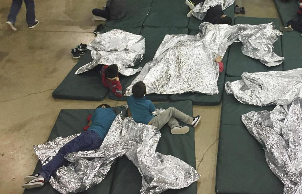 Ina photo from June 2018, people who'd been taken into custody related to cases of illegal entry into the United States, rested in one of the cages at a facility in McAllen, Texas.
