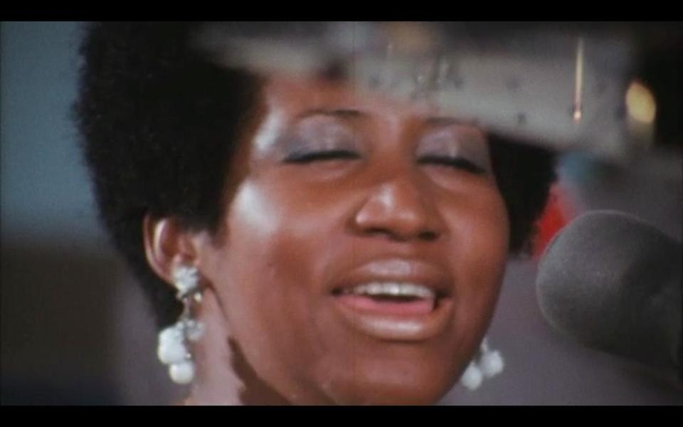 "Aretha Franklin recording gospel album Amazing Grace in 1972, as seen in documentary film ""Amazing Grace."""