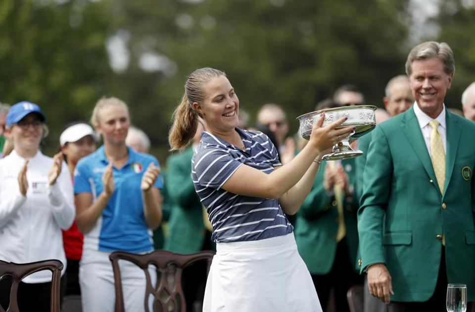 Jennifer Kupcho holds the trophy after winning the Augusta National Women's Amateur golf tournament in Augusta, Ga., Saturday, April 6, 2019. (AP Photo/David Goldman)