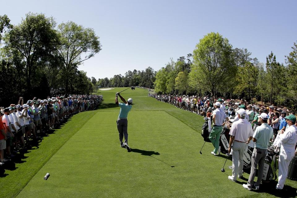 Tiger Woods hits his tee shot on the fifth hole during a practice round for the Masters golf tournament Wednesday, April 10, 2019, in Augusta, Ga. (AP Photo/Charlie Riedel)