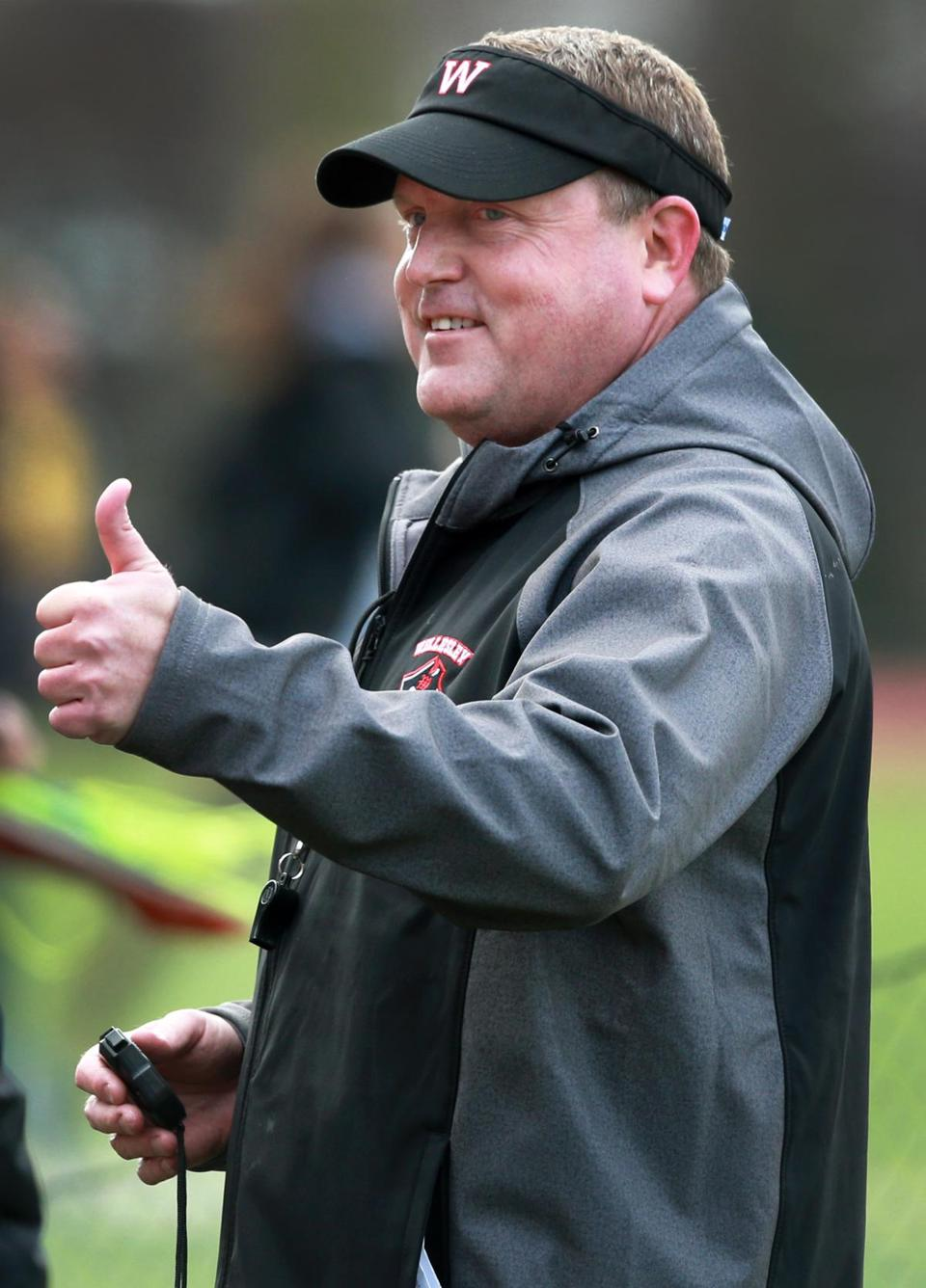 Coach John Griffith likes what he sees during Wellesley's meet against Framingham.