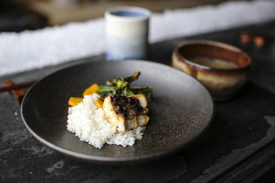 Providence, RI--04/12/2019--Grilled John Dory served with rice, Chinese broccoli and pickled butternut squash with a side of squash broth at Big King in Providence, RI. (Nathan Klima for The Boston Globe) Topic: 17diningoutpic Reporter: