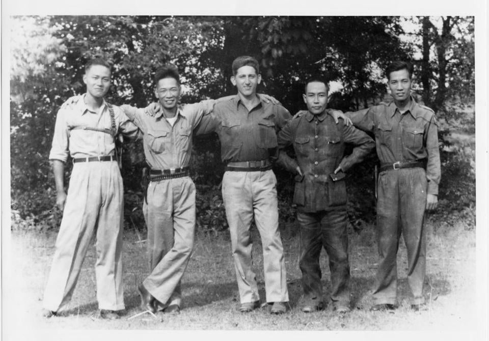 "Mr. Pinck wrote the memoir ""Journey to Peking"" about his months in China for the OSS. Above, Mr. Pinck and his group of friends, from left to right: interpreter Shum Hay, Colonel Chen, Mr. Pinck, provincial magistrate Chai Cho Man, and radio operator Lung Chiu Wah."