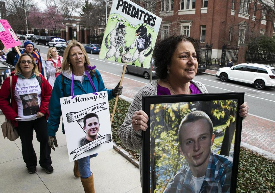 CAMBRIDGE, MA - 04/12/2019 Nancy Tobin, far right, walks ahead of national advocacy groups made up of parents who have lost a child to opioid overdose as they march outside of the Arthur M Sackler Museum at a protest to demand removal of the Sackler name from any public space. Tobin lost her 22-year-old son, Scott, to an overdose in 2017. (Erin Clark for The Boston Globe)