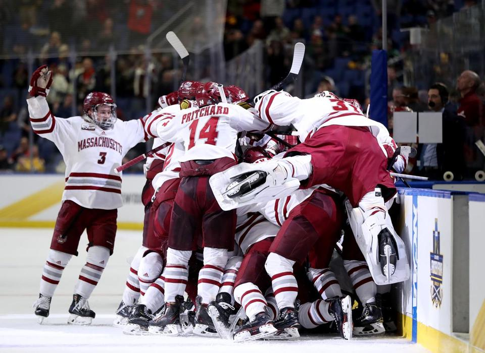UMass celebrated its overtime win over Denver in the Frozen Four semifinals.