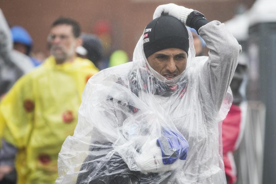Runners make their way through the rain in the Athletes' Village before the Boston Marathon.