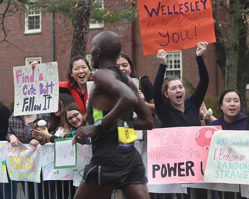 Spectators near Wellesley College had a glut of cheeky signs.