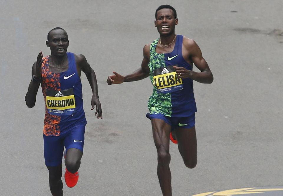 Boston, MA, 04/15/2019 -- Men's winner Lawrence Cherono (L) and Lelisa Desisa run down Boylston Street towards the Finish Line of the 123rd Boston Marathon. (Jessica Rinaldi/Globe Staff) Topic: 16marathonphotos Reporter: