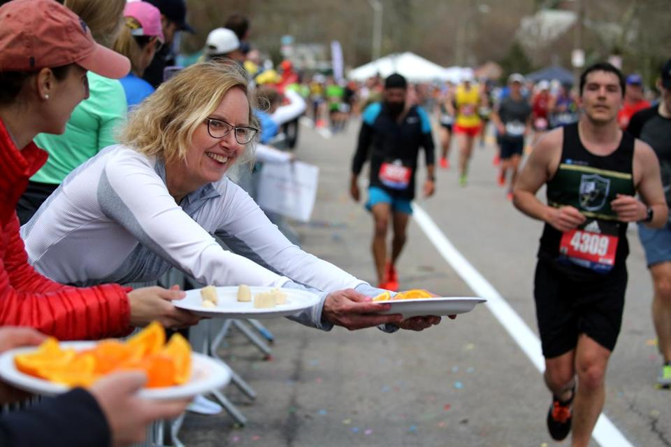 OK — so, this isn't a sign, but Susan Whoriskey was offering oranges to runners on Heartbreak Hill.