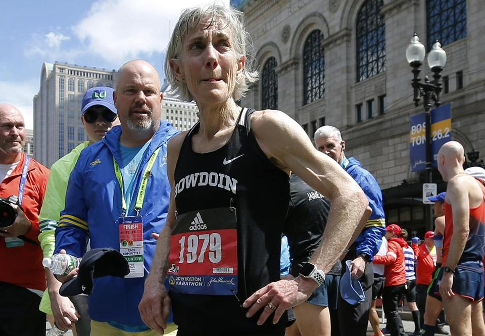 Joan Benoit Samuelson, first women's Olympics marathon winner, walks from the finish line after finishing the 123rd Boston Marathon on Monday, April 15, 2019, in Boston. (AP Photo/Winslow Townson)