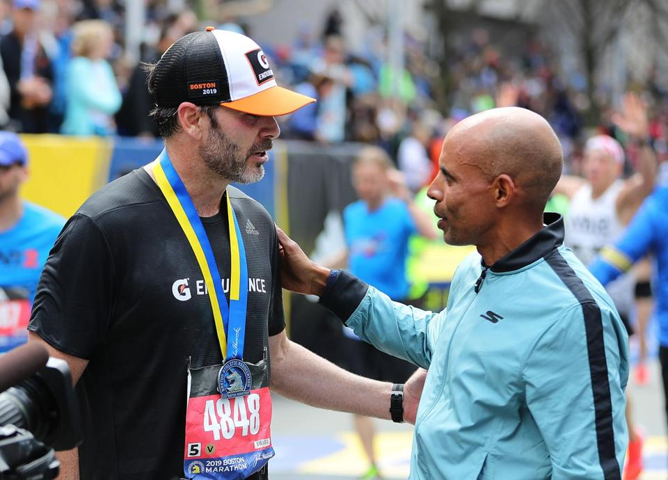 Jimmie Johnson was congratulated by 2014 Boston Marathon winner Meb Keflezighi at the finish line.
