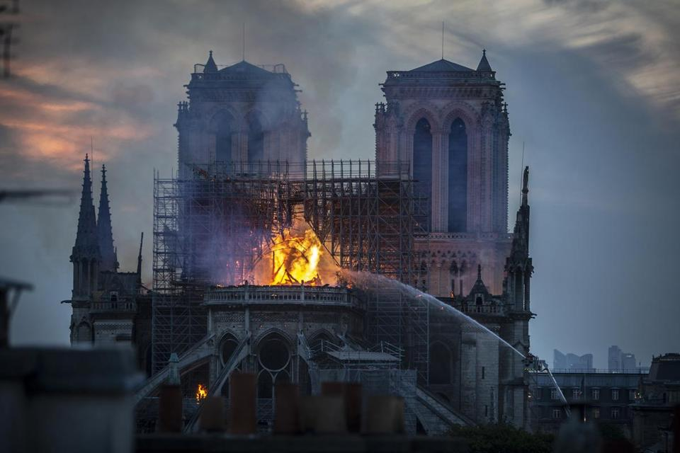 Smoke and flames rose from Notre Dame Cathedral on Monday.