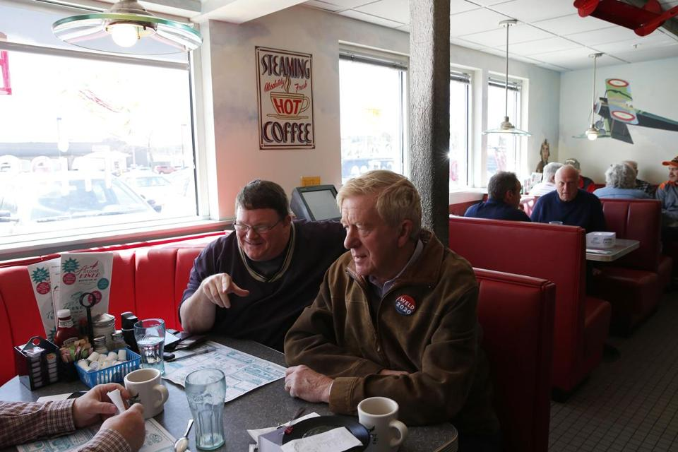 Manchester, NH, 04/16/2019 -- Governor Bill Weld (R) sits beside David Welch of Ware, NH as he stops to chat with him and a friend during a campaign stop at the Airport Diner. Weld announced his candidacy to run for President of the United States of America in the Republican Primary. (Jessica Rinaldi/Globe Staff) Topic: 17weld Reporter: