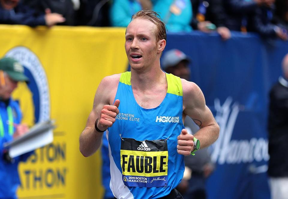 Boston-04/15/2019 The Boston Marathon finish line- Scott Fauble, the first mens USA runner crosses the finish line. Photo by John Tlumacki/Globe Staff(sports)