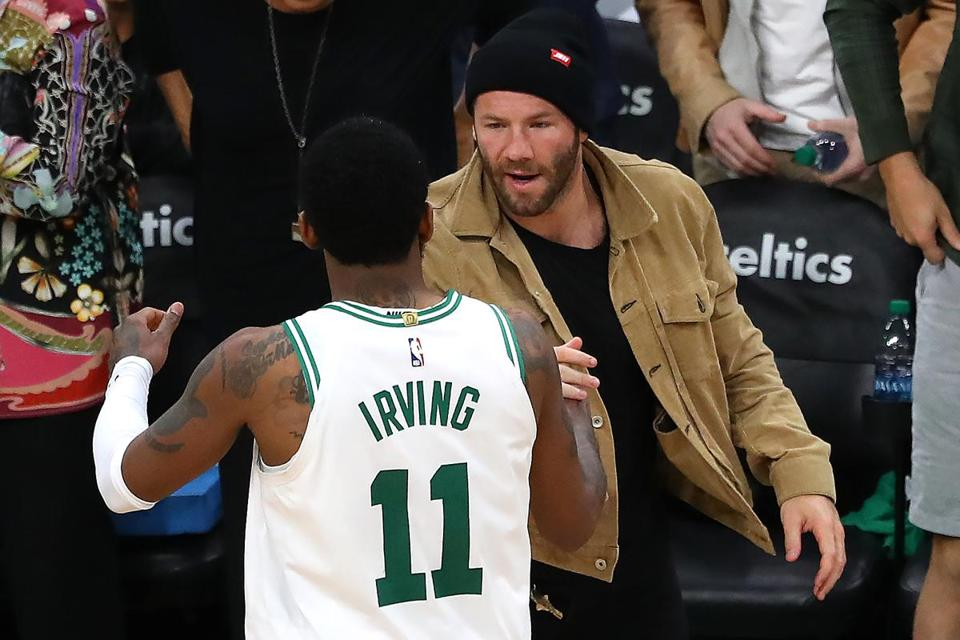 BOSTON, MASSACHUSETTS - APRIL 17: Kyrie Irving #11 of the Boston Celtics celebrates with Julian Edelman of the New England Patriots after the Boston Celtics defeat the Indiana Pacers 99-91 in Game Two of Round One of the 2019 NBA Playoffs at TD Garden on April 17, 2019 in Boston, Massachusetts. NOTE TO USER: User expressly acknowledges and agrees that, by downloading and or using this photograph, User is consenting to the terms and conditions of the Getty Images License Agreement. (Photo by Maddie Meyer/Getty Images)