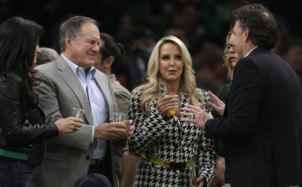New England Patriots head coach Bill Belichick talks with Boston Celtics owner Wyc Grousbeck, right, during the second quarter of Game 2 of an NBA basketball first-round playoff series, Wednesday, April 17, 2019, in Boston. Second from right is Belichick's girlfriend Linda Holliday, at left is Grousbeck's wife Emilia Fazzalari. (AP Photo/Charles Krupa)