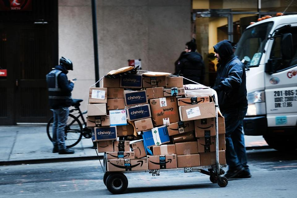 NEW YORK, NEW YORK - FEBRUARY 28: A man delivers packages along a street in midtown Manhattan on February 28, 2019 in New York City. New numbers released today by the Commerce Department show that the nation's Gross domestic product (GDP)— the broadest measure of goods and services produced in the United States- — grew only at a 2.6 percent annual rate in the final three months of last year. This is a significant slowdown from the middle of last year when the GDP briefly pushed above 4 percent. (Photo by Spencer Platt/Getty Images)