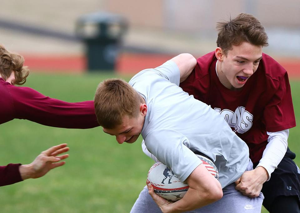 Jake Harrison takes down a teammate during rugby practice.