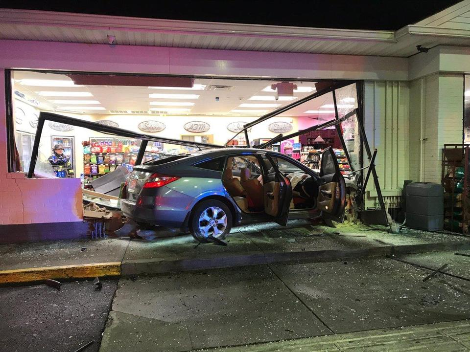 This car crashed into the Shell gas station convenience store at 945 Belmont St. in Brockton.