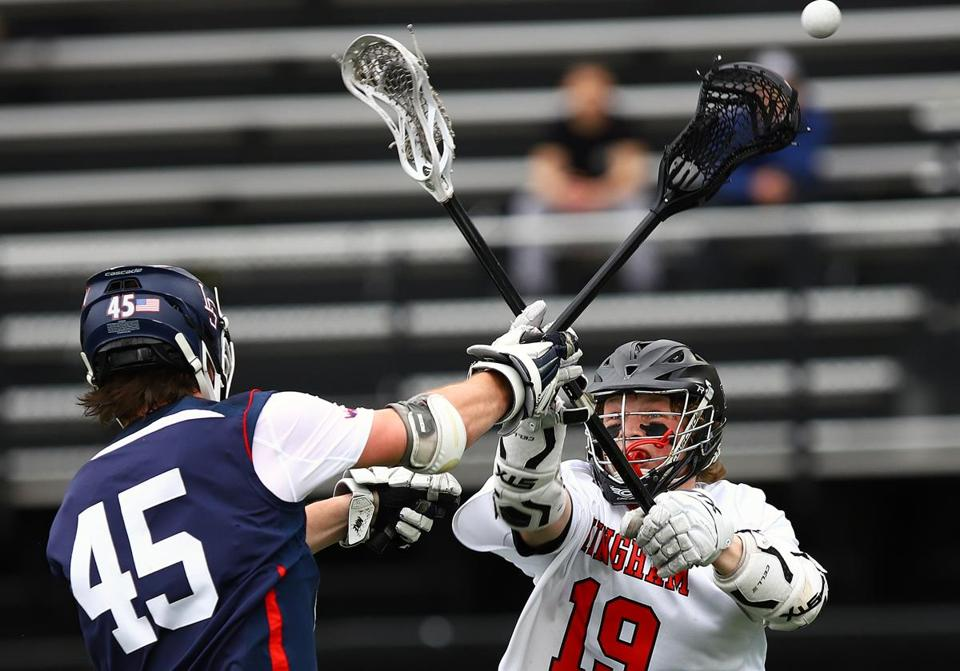 Hingham High's Jonathan Bearden tries to stop Finn Garrity's pass in game, during the final of the Coaches Cup at Winchester High, Saturday April 20, 2019. Mark Lorenz for the Boston Globe.