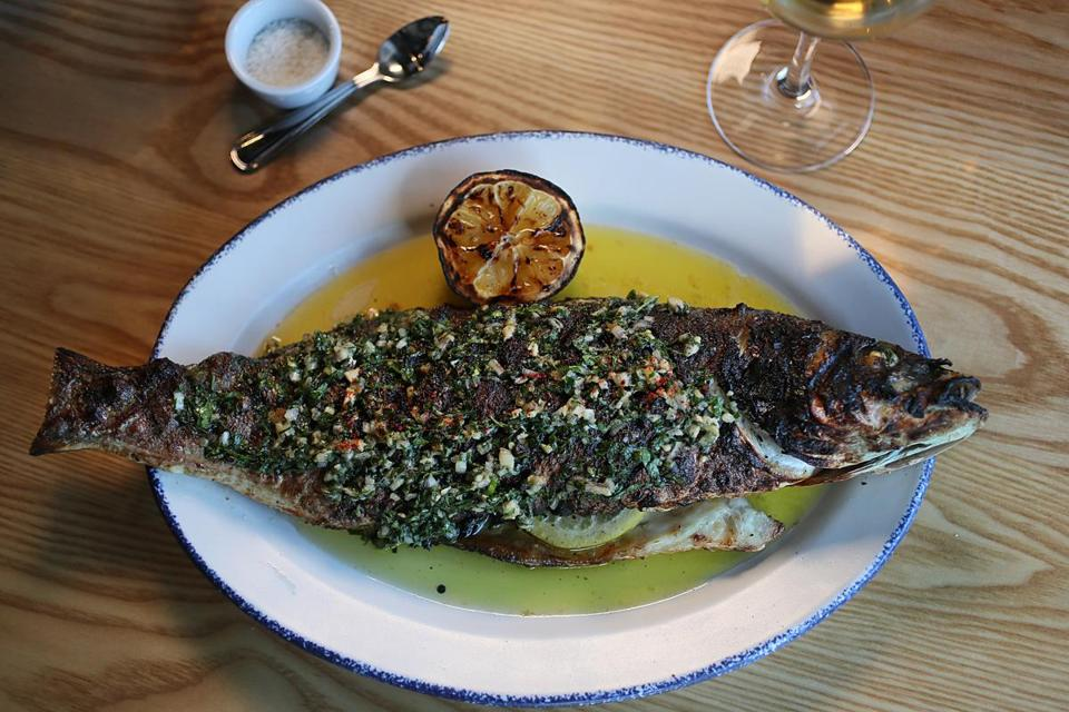 The whole branzino with a sauce of lemon, garlic, and herbs at Buttonwood Restaurant.