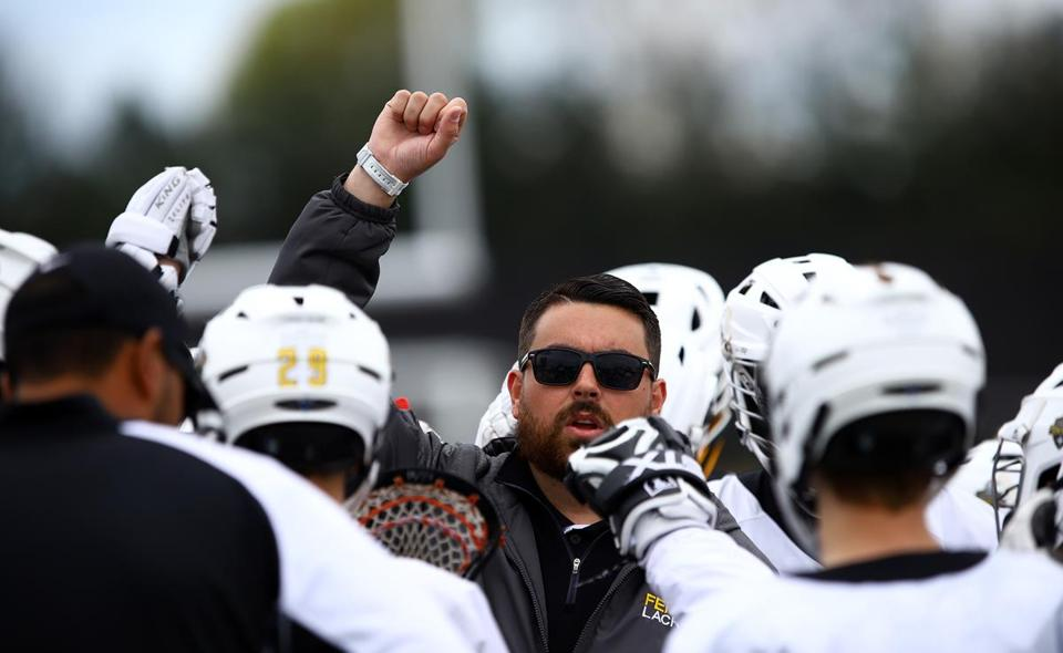 Bishop Fenwick coach Steve Driscoll, here huddling with his team in Saturday's game against St. Mary's, has helped shaped several student-athletes into excellent lacrosse players.