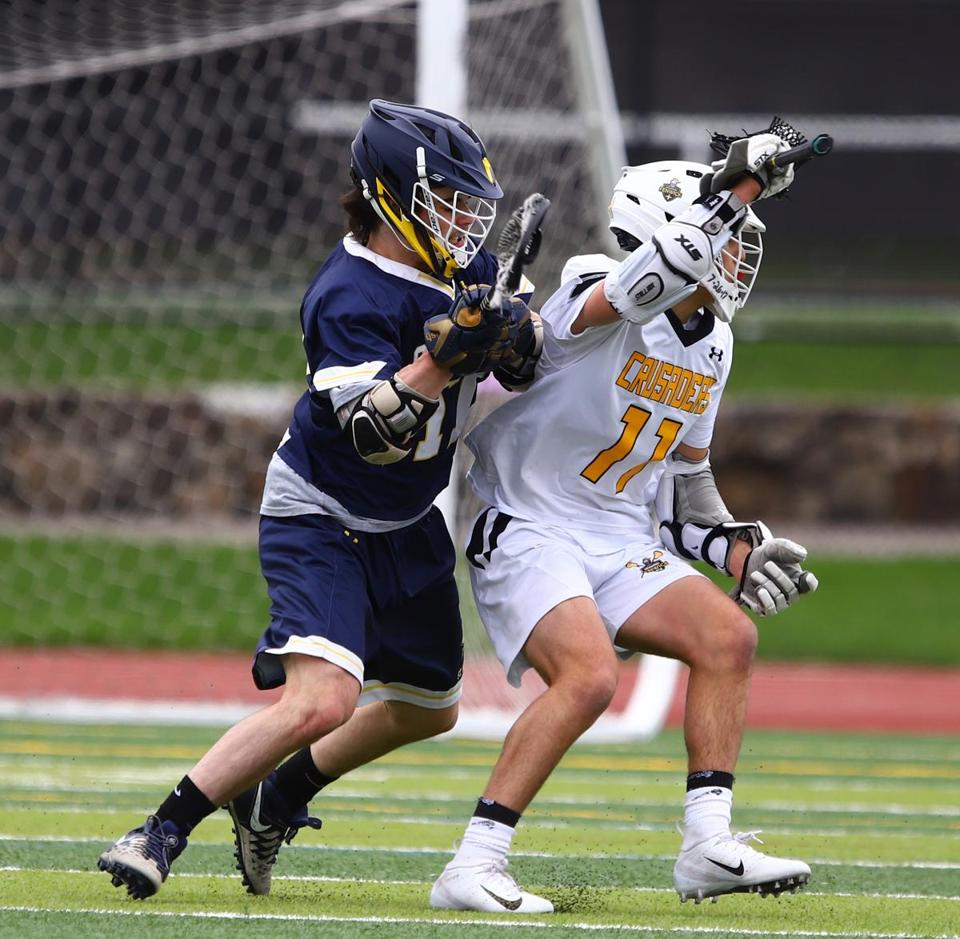 St. Mary's Damon Maribito, checks Bishop Fenwick's Stefano Fabiano (#11) in match up on Saturday April 27, 2019, at Bishop Fenwick High. Mark Lorenz for the Boston Globe.