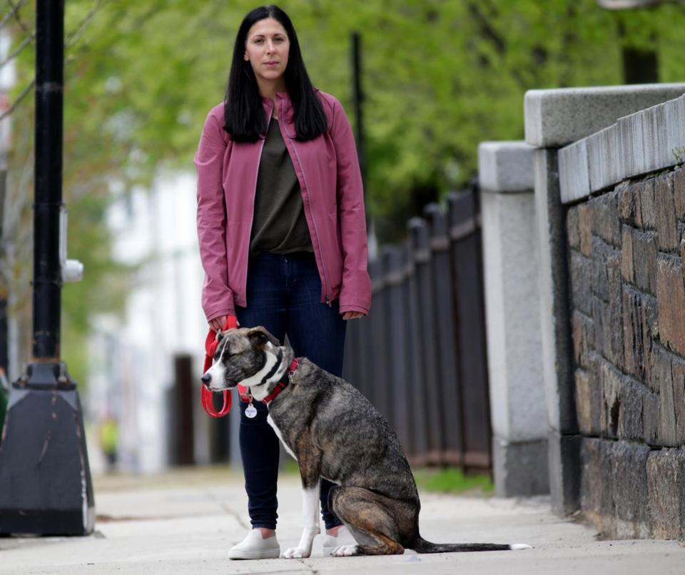 05/01/2019 Charlestown Ma - Samantha Hughes (cq) with her Dog Madden. Samantha, has paid for a Embark DNA test for her dog, and found that he has a gene, that makes him sensative to multiple veterinarian drugs. Jonathan Wiggs /GlobeStaff Reporter:Topic:dogdna