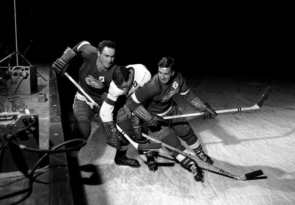 Mr. Kelly (left) and Ted Lindsay (right) battled another Red Wings teammate for the puck during hockey practice in Detroit.