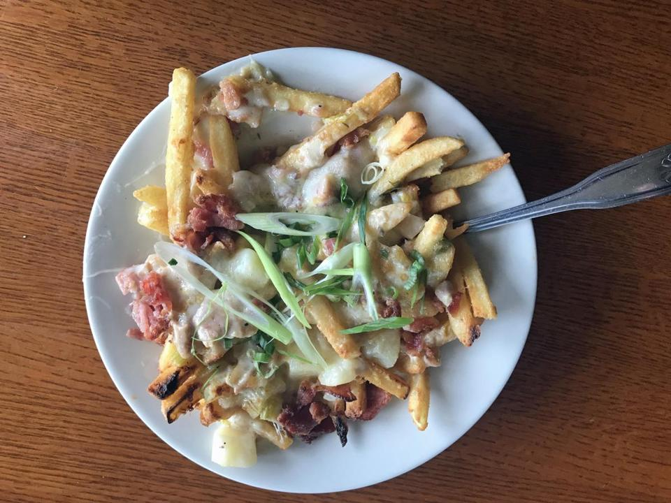 19blockisland - French fries plus chowder plus bacon plus Gouda cheese (and a sprinkling of fresh scallions to add some greens)=a Block Island classic. (Diane Bair for The Boston Globe)