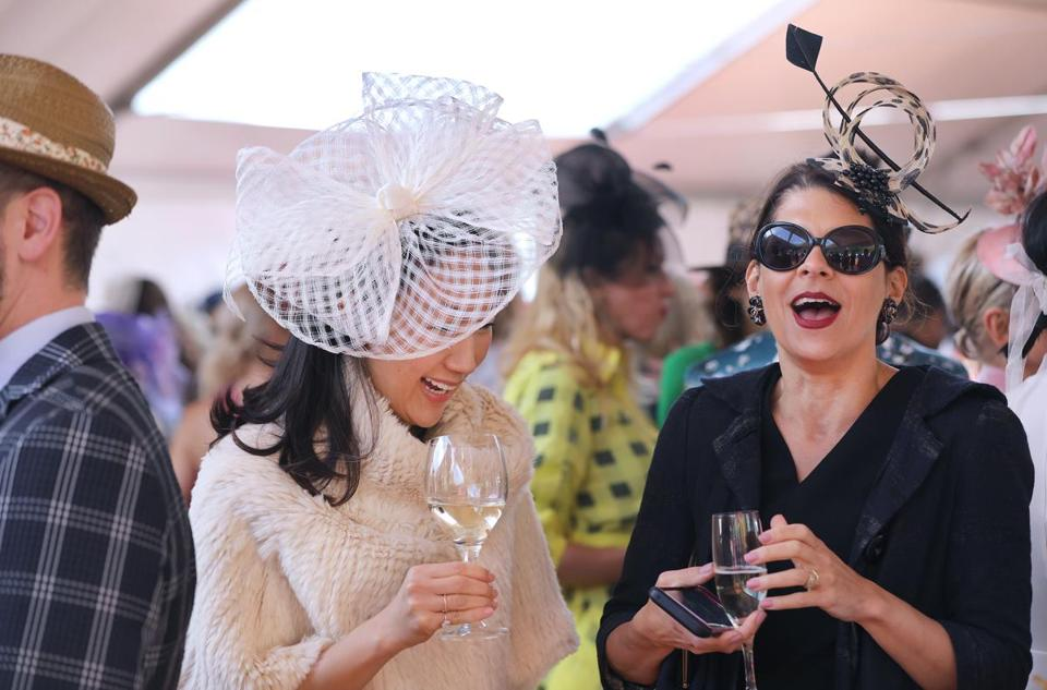Boston, MA - 5/15/19 Adelle Chang (cq), left, Back Bay, and Michelle Finamore (cq), Salem (a fashion curator at MFA) The annual Party in the Park fundraiser is held in Franklin Park. Photo by Pat Greenhouse/Globe Staff Topic: 16namesHats