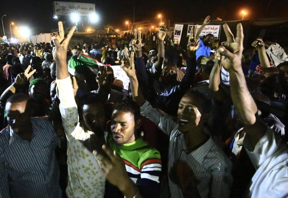 Sudanese protesters celebrated after an agreement was reached with the military council to form a three-year transition period for transferring power to democratic rule, in Khartoum, early on May 15, 2019.