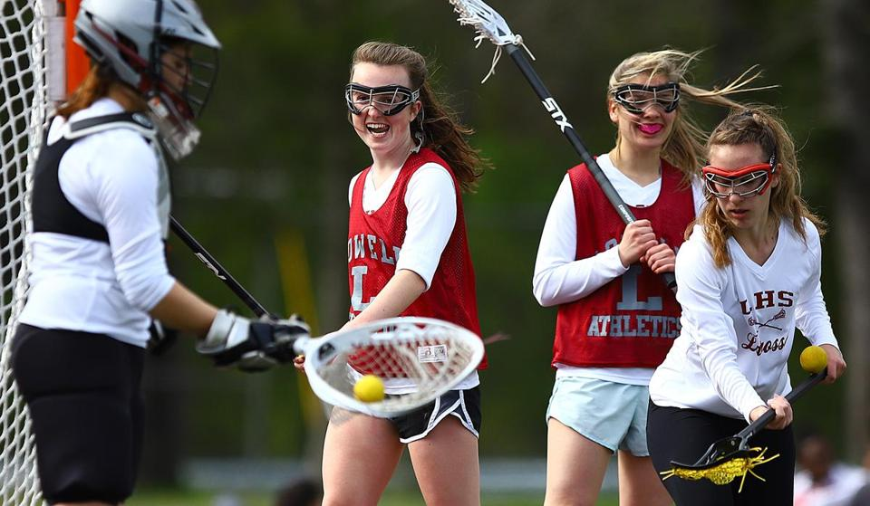 "As far as she's concerned, senior captain Hannah Erickson (center) knows why Lowell is 11-3, on a six-game winning streak, and poised to be one of the school's best girl's lacrosse teams. ""We're working more as a team because we have more skilled players, all around,"" she said."