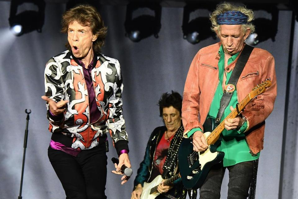 The Rolling Stones announced new United States and Canada tour dates after the band was forced to postpone planned performances so legendary frontman Mick Jagger could undergo heart surgery. (Pictured, left to right) Mick Jagger, Ronnie Wood, and Keith Richards in a 2018 file photo.