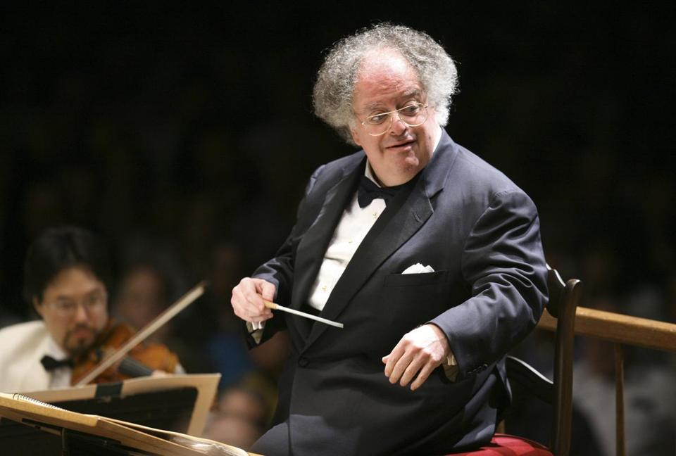 FILE - In this July 7, 2006 file photo, Boston Symphony Orchestra music director James Levine conducts the symphony on its opening night performance at Tanglewood in Lenox, Mass. Records show conductor James Levine's company received $936,755 from the Metropolitan Opera in his 47th and final season, a tenure cut short when he was fired as music director emeritus after an investigation found evidence of sexual abuse and harassment. (AP Photo/Michael Dwyer, File)