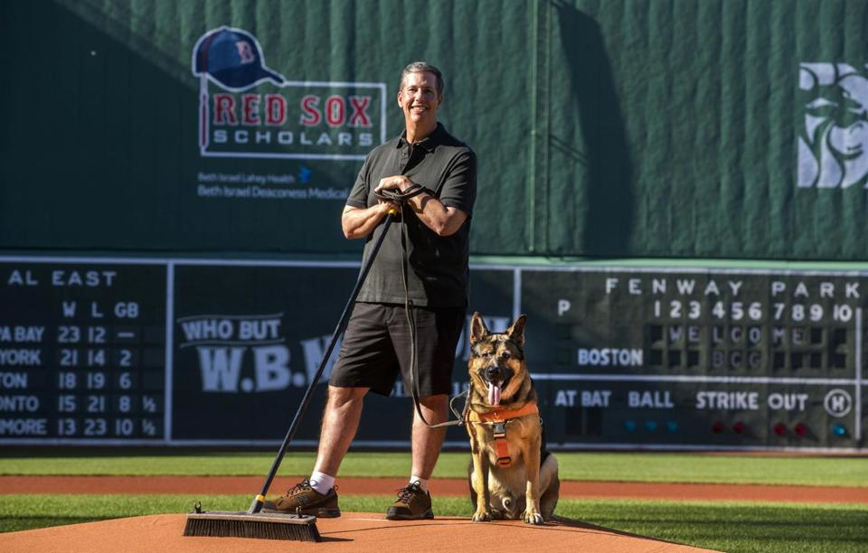 David Mellor with his service dog, Drago, at Fenway Park.
