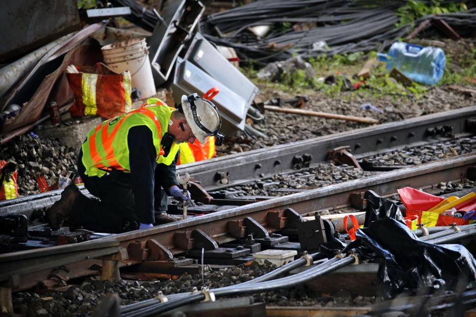In June, crews worked to repair the damage after a Red Line train derailed.