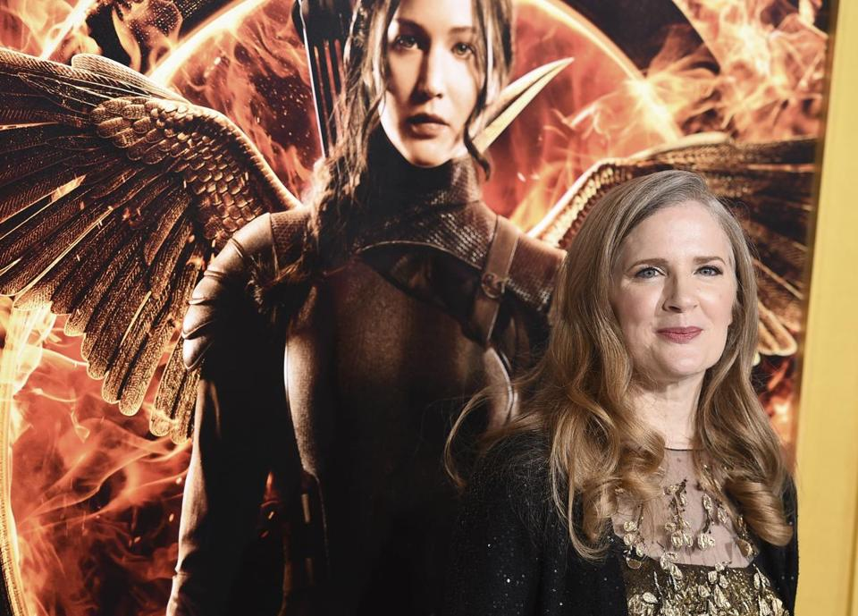 "FILE - In a Monday, Nov. 17, 2014 file photo, Suzanne Collins arrives at the Los Angeles premiere of ""The Hunger Games: Mockingjay - Part 1"" at the Nokia Theatre L.A. Live. A decade after seemingly wrapping up ""The Hunger Games,"" Suzanne Collins is bringing readers back to Panem. A prequel, set 64 years before the beginning of her multimillion-selling trilogy, is scheduled for release on May 19, 2020. (Photo by Jordan Strauss/Invision/AP, File)"