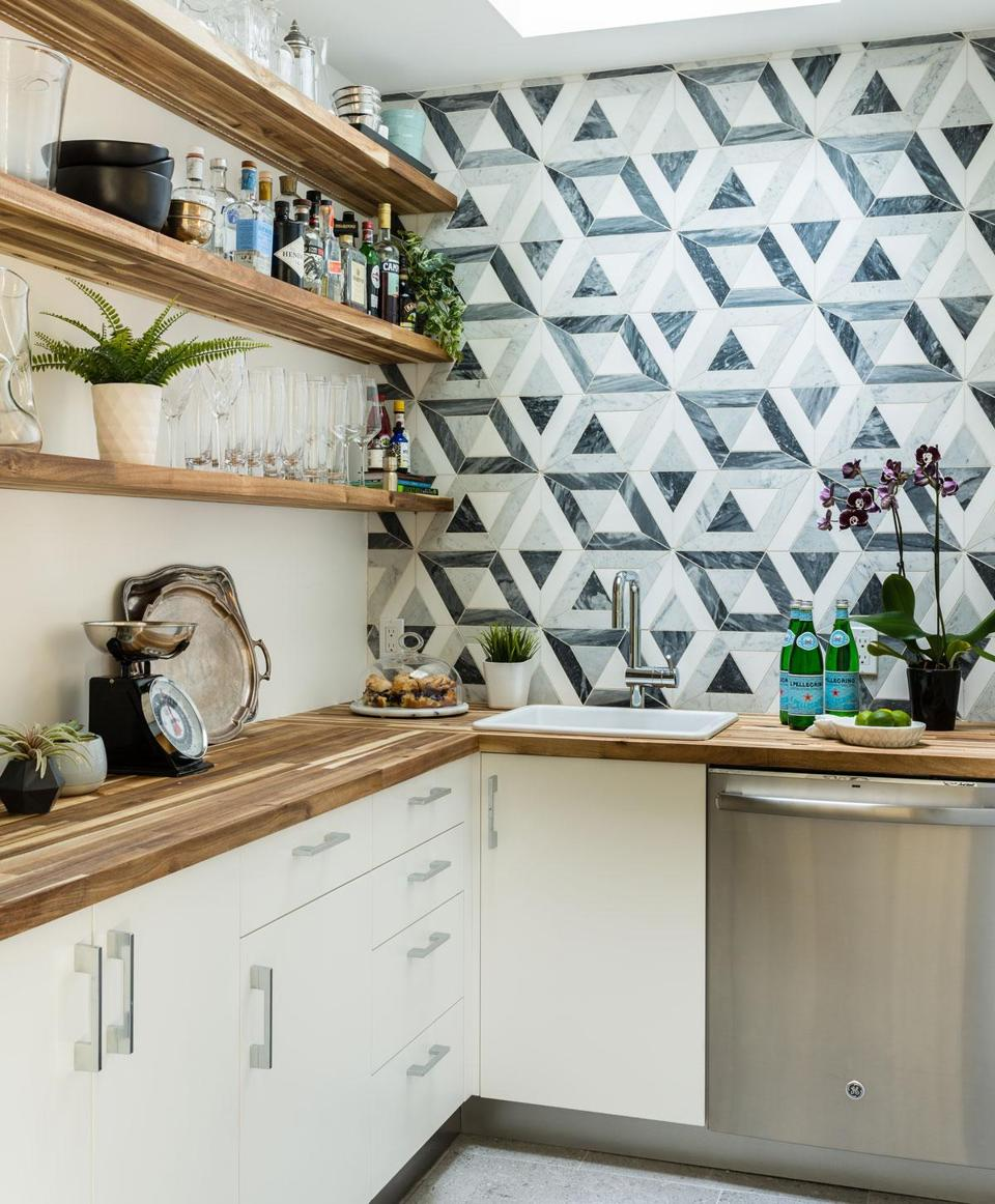 Geometric tile from Ann Sacks covers a wall in the butler's pantry, a new addition off the kitchen.