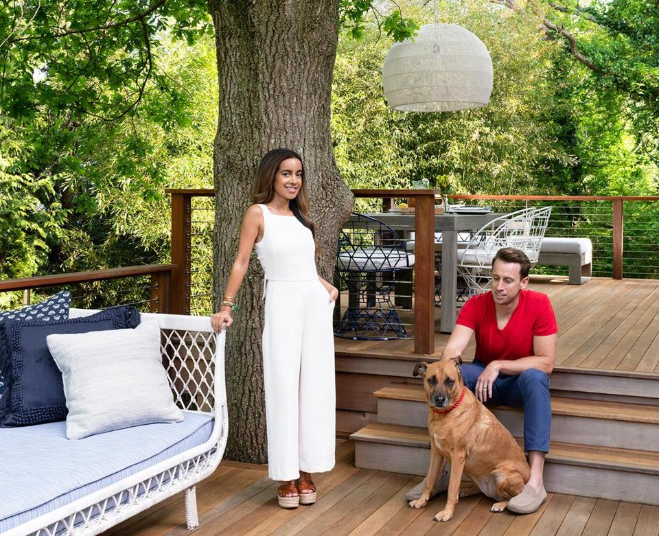 Designer Desiree Burns, her husband, Christian, and their dog, Sloane, on the deck of their home in Newport, Rhode Island.