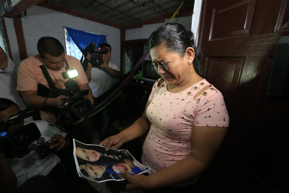 Rosa Ramirez cried when shown a photograph printed from social media of her son Oscar Alberto Martinez Ramírez, 25, granddaughter Valeria, nearly 2, and her daughter-in-law Tania Vanessa Avalos, 21.