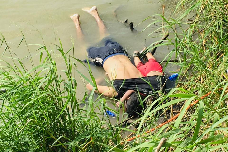 The bodies of Salvadoran migrant Oscar Alberto Martínez Ramírez and his nearly 2-year-old daughter, Valeria, laid on the bank of the Rio Grande in Matamoros, Mexico, on Monday after they drowned trying to cross the river to Brownsville, Texas.